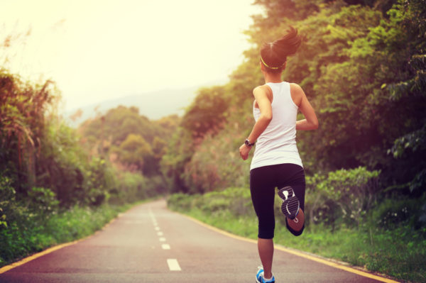 young fitness woman runner running on trail